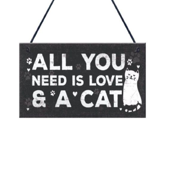 Cartel de madera con ilustración de gato